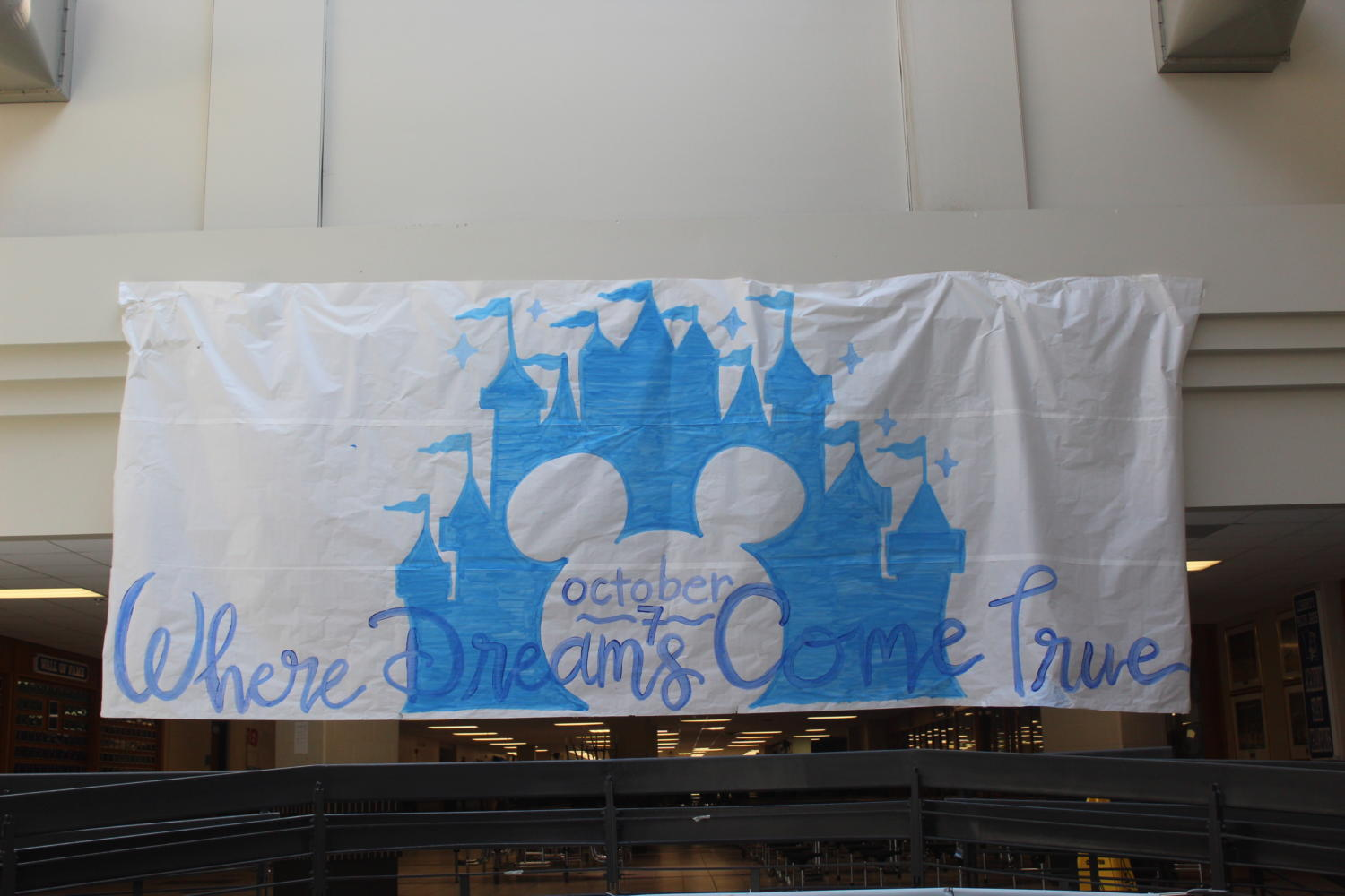 StuCo members advertise the Disney themed homecoming with a banner in the atrium, promoting the dance on October 7. Photo by McKenna Hegger