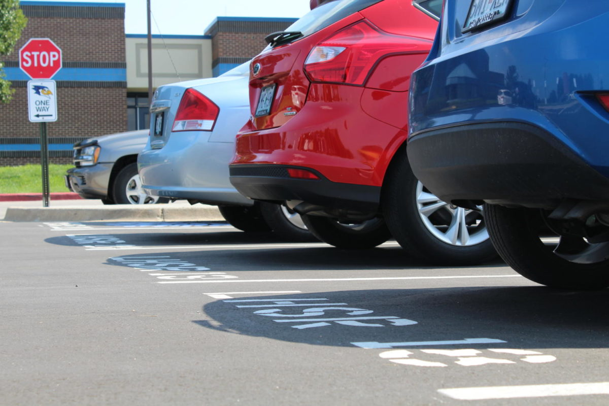 Students make the switch to new open parking rules for the new school year. Photo by Morgan Clark.
