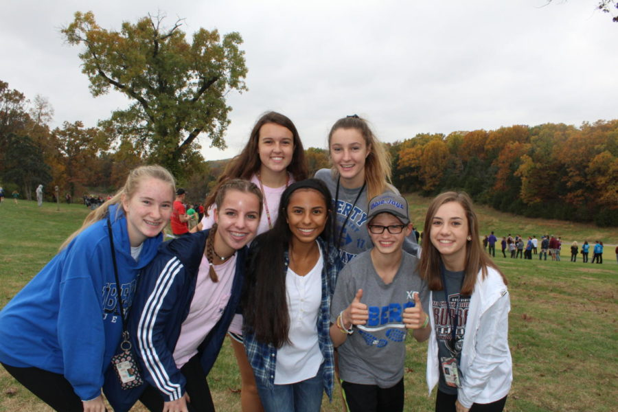 Members+of+the+cross+country+team+gather+for+a+photo+at+a+late+season+meet.+Photo+by+Alyssa+Griffith.