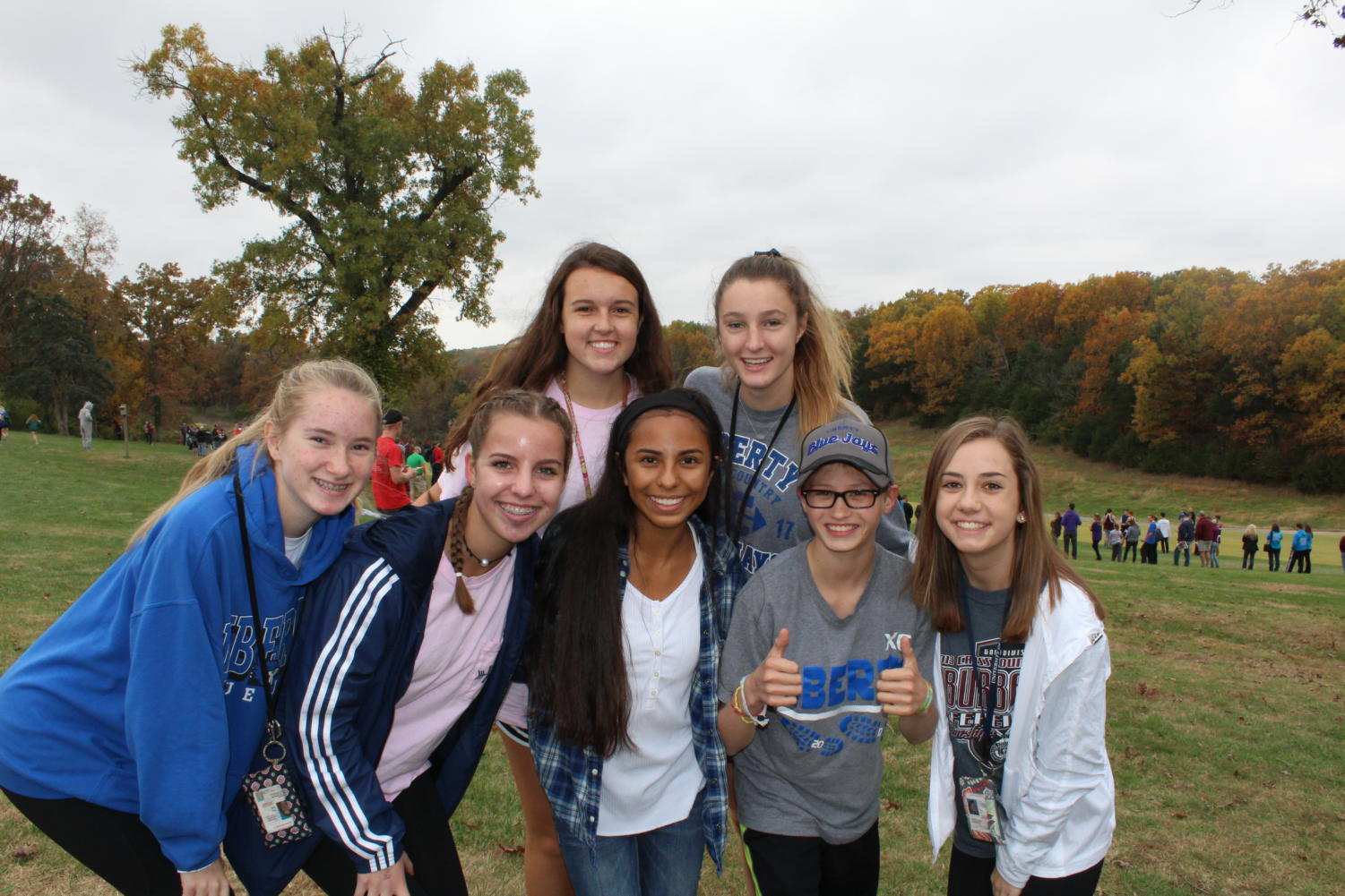 Members of the cross country team gather for a photo at a late season meet. Photo by Alyssa Griffith.