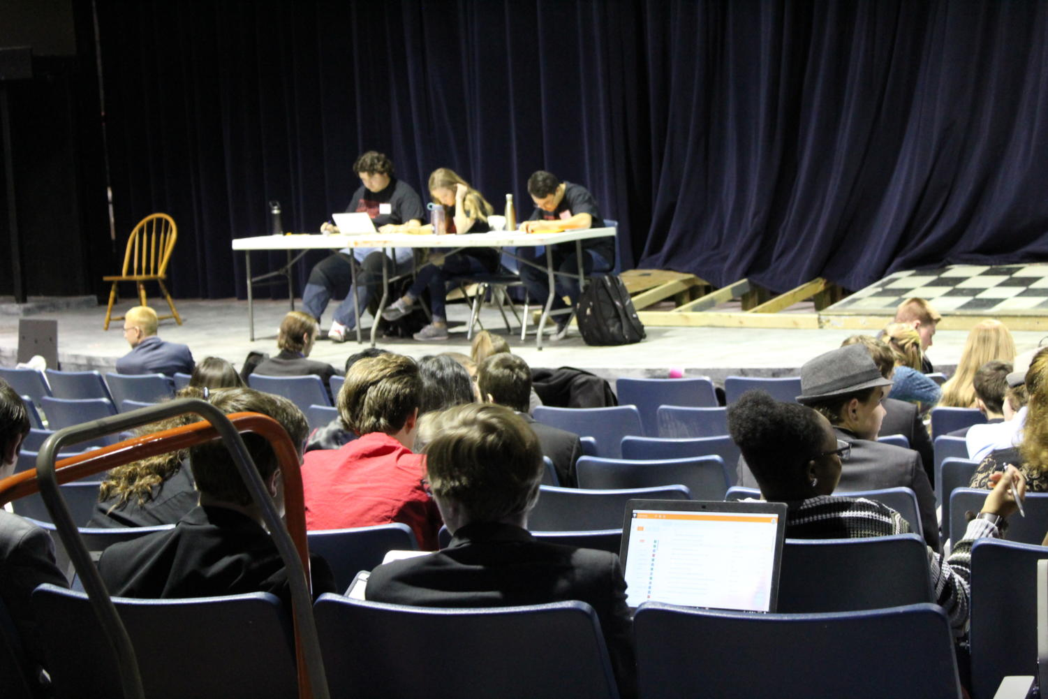 Photo by Jenna Axsom.                     Students from the 50+ schools that came to debate gathered to prepare in the Little Theater before their rounds.