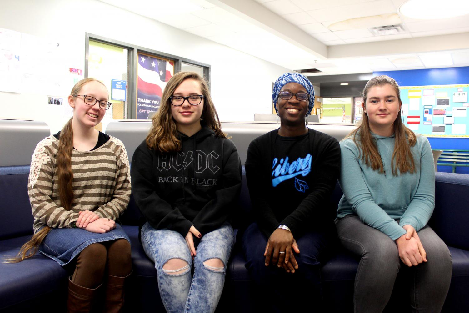 Freshman Liberty Dilbeck, sophomore Emma Tatum, club sponsor Eniola Ajayi, and junior Elizabeth Hall are part of Society of Women Engineers. The club explores STEM opportunities. Photo by Charlene Nguyen.