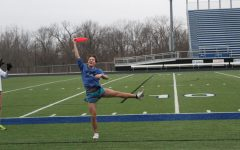 """Sophomore Reagan Manis catches a frisbee while participating in a game of ultimate frisbee during an FCA meeting. """"It's a really easy game to understand and to play that requires hardly any equipment at all,"""" senior Peter Mallon said. """"The game has gotten so popular among the members of FCA,"""
