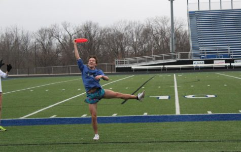 "Sophomore Reagan Manis catches a frisbee while participating in a game of ultimate frisbee during an FCA meeting. ""It's a really easy game to understand and to play that requires hardly any equipment at all,"" senior Peter Mallon said. ""The game has gotten so popular among the members of FCA,"